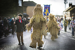 January 14, 2017 - Whittlesey, Cambridgshire, UK - Whittlesey UK. Picture shows the Straw Bear being led through the town of Whittlesey at the 38th Straw Bear festival. In Whittlesey it was the custom on the Tuesday following Plough Monday to dress one of the confraternity of the plough in straw and call him a Straw Bear. The bear was then taken around town to entertain the folk who on the previous day had subscribed to the rustics, a spread of beer, tobacco & beef. The bear was made to dance in front of houses & gifts of money, beer & food was expected. (Credit Image: © Andrew Mccaren/London News Pictures via ZUMA Wire)