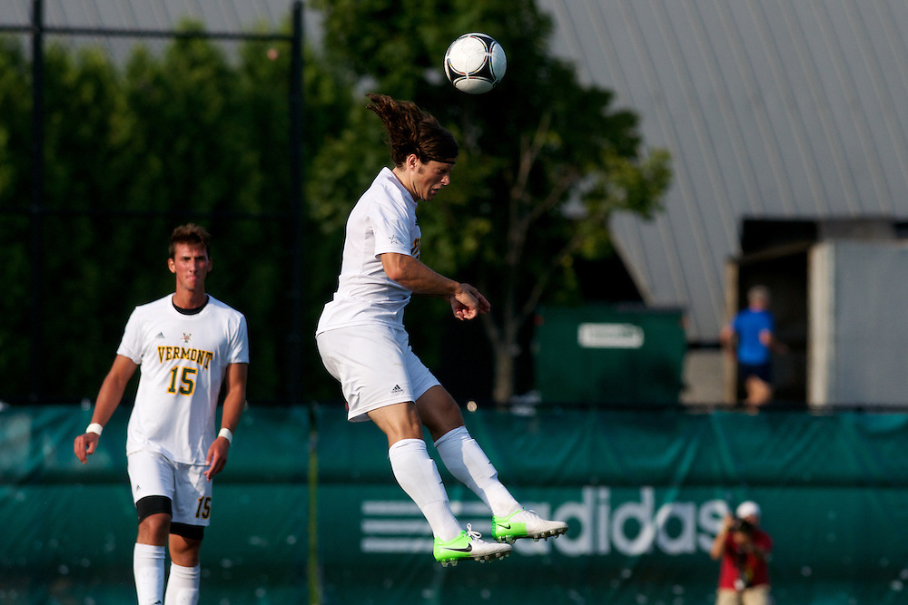 Catamounts defenseman Sean Sweeney (2) heads the ball during the men's soccer game between the Central Connecticut State University Blue Devils and the Vermont Catamounts at Virtue Field on Friday afternoon September 7, 2012 in Burlington, Vermont.