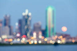 Abstract view of downtown and full moon during Trinity River flood, Dallas, Texas, USA
