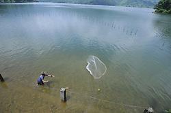 July 29, 2017 - Pokhara, NP, Nepal - A Nepalese fisherman casting a net for catching freshwater fish at Begnas Lake, Pokhara, Nepal on Saturday, July 29, 2017. (Credit Image: © Narayan Maharjan/NurPhoto via ZUMA Press)