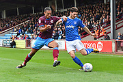 Portsmouth midfielder Matthew Kennedy (11) and Scunthorpe United defender Jordan Clarke (2)  during the EFL Sky Bet League 1 match between Scunthorpe United and Portsmouth at Glanford Park, Scunthorpe, England on 23 September 2017. Photo by Ian Lyall.
