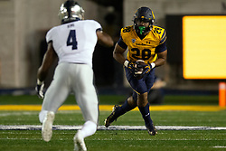 California running back Damien Moore (28) tries to escape the pursuit of Nevada defensive back A.J. King (4) during the third quarter of an NCAA college football game, Saturday, Sept. 4, 2021, in Berkeley, Calif. (AP Photo/D. Ross Cameron)