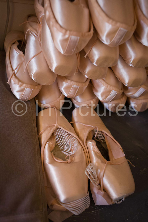 Pointe shoes belonging to a prima ballerina in her dsressing room at the Palais Garnier, Paris. A pointe shoe is a type of shoe worn by ballet dancers when performing pointe work. Pointe shoes were conceived in response to the desire for dancers to appear weightless and sylph-like and have evolved to enable dancers to dance en pointe (on the tips of their toes) for extended periods of time. They are normally worn by female dancers, though male dancers may wear them for unorthodox roles such as the ugly stepsisters in Cinderella, or in dance companies that feature men dancing as women, such as Les Ballets Trockadero. They are manufactured in a variety of colors, most commonly in shades of light pink.