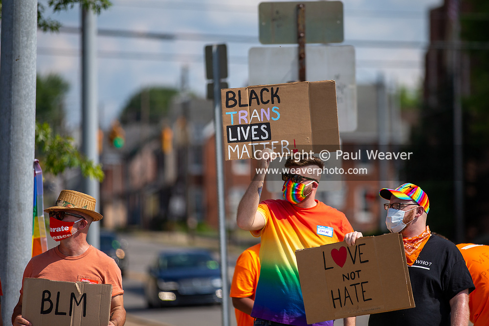 Demonstrators hold up signs during a Pride Rally in Milton, Pennsylvania on August 8, 2020. The I Am Alliance organized the event to show support for the LGBTQ community. (Photo by Paul Weaver)