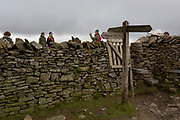 Walkers on the summit of Pen-y-Ghent in the Yorkshire Dales National Park, on 13th April 2017, in Horton in Ribblesdale, Yorkshire, England.