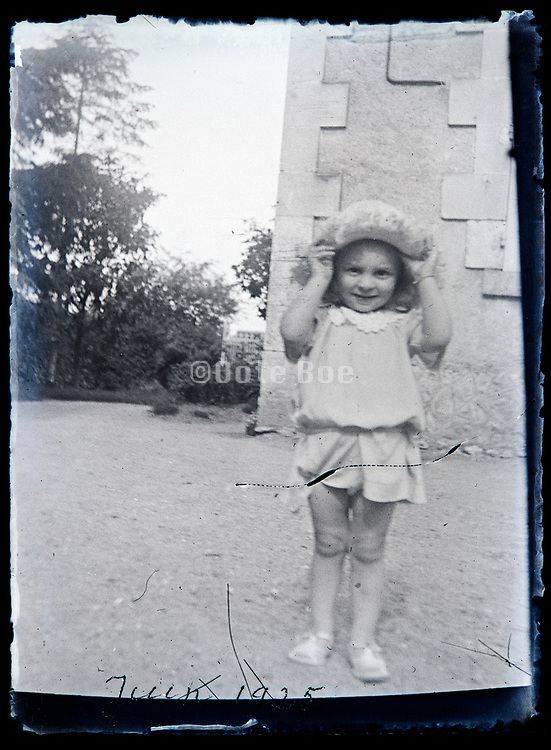 happy little child playing with a hat outside France circa 1930s