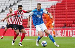 Mark Beevers of Peterborough United in action with Jordan Willis of Sunderland - Mandatory by-line: Joe Dent/JMP - 26/09/2020 - FOOTBALL - Stadium of Light - Sunderland, England - Sunderland v Peterborough United - Sky Bet League One