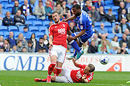 Cardiff City's Junior Hoilett (c) is tackled by Nottingham's David Vaughan (on floor) and Daniel Pinillos. EFL Skybet championship match, Cardiff city v Nottingham Forest at the Cardiff City Stadium in Cardiff, South Wales on Easter Monday 17th April 2017.<br /> pic by Carl Robertson,