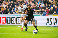 ( L-R ) Federico Fernandez of Swansea City and Shinji Okazaki of Leicester City in action. Premier league match, Swansea city v Leicester city at the Liberty Stadium in Swansea, South Wales on Saturday 21st October 2017.<br /> pic by Aled Llywelyn, Andrew Orchard sports photography.