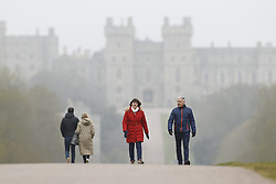© Licensed to London News Pictures. 04/04/2020. Windsor, UK. People walk and run on The Long Walk near Windsor Castle on a misty morning. Quuen Elizabeth will address the nation tomorrow in a rare speech from Windsor Castle.  As death rates continue to rise the public have been told they can only leave their homes when it is absolutely essential, in an attempt to fight the spread of coronavirus COVID-19 disease. Photo credit: Peter Macdiarmid/LNP
