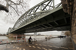Cologne, Germany, Jan. 2012 -  Pedestrians and cyclists make their way along the Rhein River under the Hohenzollern bridge, in Cologne, Germany. (Photo © Jock Fistick).