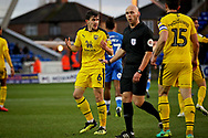Oxford United's Jamie Hanson (6) pleads with the referee during the EFL Sky Bet League 1 match between Peterborough United and Oxford United at London Road, Peterborough, England on 8 December 2018.