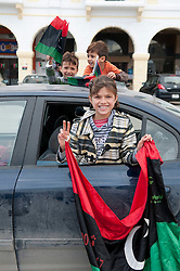 © licensed to London News Pictures. TRIPOLI, LIBYA  17/02/12. Kids wave the Libyan flag in Martyrs' Square in Tripoli, Libya on the one year anniversary of the revolution. Please see special instructions for usage rates. Photo credit should read MICHAEL GRAAE/LNP