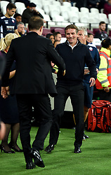 """Bolton Wanderers manager Phil Parkinson (right) shakes hands with West Ham United manager Slaven Bilic (left) during the Carabao Cup, third round match at the London Stadium. PRESS ASSOCIATION Photo. Picture date: Tuesday September 19, 2017. See PA story SOCCER West Ham. Photo credit should read: Daniel Hambury/PA Wire. RESTRICTIONS: EDITORIAL USE ONLY No use with unauthorised audio, video, data, fixture lists, club/league logos or """"live"""" services. Online in-match use limited to 75 images, no video emulation. No use in betting, games or single club/league/player publications."""