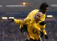 Photo: Glyn Thomas.<br />Birmingham City v Arsenal. The Barclays Premiership. 04/02/2006.<br />Arsenal's Thierry Henry (R) celebrates scoring his side's second goal with Emmanuel Adebayor.