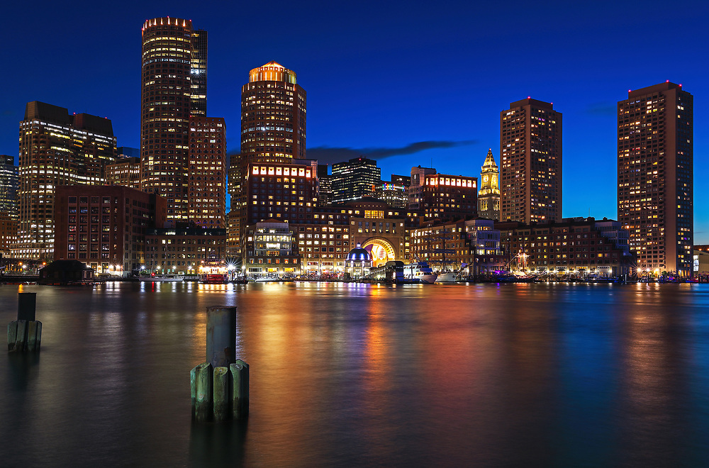Sail Boston tall ships Europa and Atyla moored in the Boston Harbor with waterfront skyline photography from New England photographer Juergen Roth. The image shows the historic sailboats in front of the Boston Financial Waterfront District landmarks such as the Custom House of Boston, One International Place, Boston Harbor Hotel photographed on a beautiful summer sunset evening durin Sail Boston.<br /> <br /> Sail Boston photos are available as museum quality photo prints, canvas prints, wood prints, acrylic prints or metal prints. Fine art prints may be framed and matted to the individual liking and decorating needs:<br /> <br /> https://juergen-roth.pixels.com/featured/sail-boston-tall-ships-europa-and-atyla-juergen-roth.html<br /> <br /> All digital Boston tall ships photography images are available for photo image licensing at www.RothGalleries.com. Please contact me direct with any questions or request.<br /> <br /> Good light and happy photo making!<br /> <br /> My best,<br /> <br /> Juergen<br /> Prints: http://www.rothgalleries.com<br /> Photo Blog: http://whereintheworldisjuergen.blogspot.com<br /> Instagram: https://www.instagram.com/rothgalleries<br /> Twitter: https://twitter.com/naturefineart<br /> Facebook: https://www.facebook.com/naturefineart