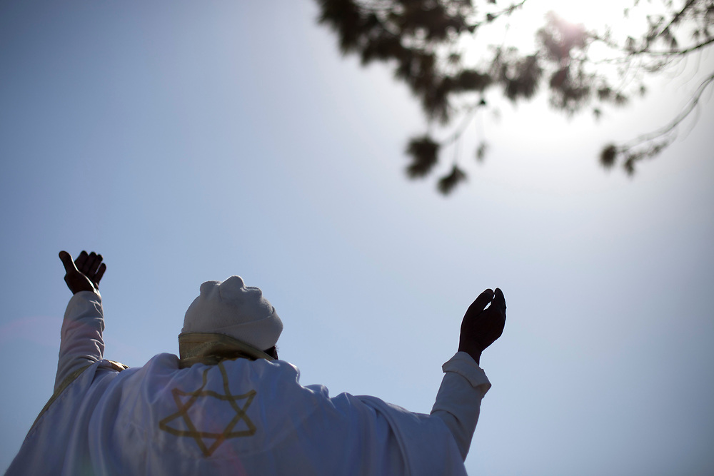 """An Ethiopian Jewish man prays during a ceremony marking the Ethiopian Jewish holiday of Sigd in Jerusalem, on November 04, 2010. The holiday symbolizes the community's desire for """"return to Jerusalem""""."""