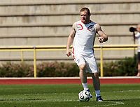Photo: Chris Ratcliffe.<br />England Training Session. FIFA World Cup 2006. 13/06/2006.<br />Wayne Rooney warms up during training.