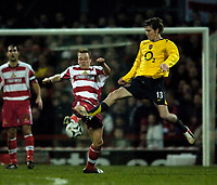 Photo: Jed Wee.<br /> Doncaster Rovers v Arsenal. Carling Cup. 21/12/2005.<br /> <br /> Arsenal's Alexander Hleb (R) challenges Doncaster's Steve Roberts for possession.