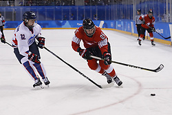February 18, 2018 - Pyeongchang, KOREA - Switzerland forward Dominique Ruegg (26) and Korea forward Heewon Kim (12) in a hockey game between Switzerland and Korea during the Pyeongchang 2018 Olympic Winter Games at Kwandong Hockey Centre. Switzerland beat Korea 2-0. (Credit Image: © David McIntyre via ZUMA Wire)