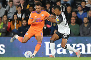 Cardiff City midfielder Josh Murphy and Derby County defender Max Lowe challenge for the ball during the EFL Sky Bet Championship match between Derby County and Cardiff City at the Pride Park, Derby, England on 13 September 2019.