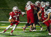 Jacob Filgate gets the blocks by his teammates to advance the ball during Friday night's Homecoming football game with Pembroke Academy.  (Karen Bobotas/for the Laconia Daily Sun)