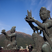 Tourists visit the Giant Buddha at Po Lin Monastery near Ngong Ping village. A tourist takes a picture with her iPad.