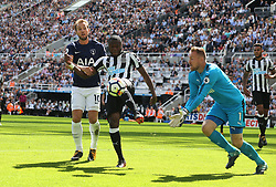 13 August 2017  : Premier League Football : Newcastle United v Tottenham Hotspur:  Chancel Mbemba of Newcastle clears the ball before his goalkeeper Rob Elliot can gather, as Harry Kane watches: Photo: Mark Leech