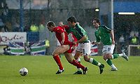 Photo: Andrew Unwin.<br />Northern Ireland v Wales. World Cup Qualifier.<br />08/10/2005.<br />Northern Ireland's Damien Johnson (C) takes hold of the shorts of Wales' David Vaughan (L).