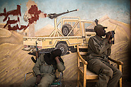 When Al Qaeda took over Timbuktu, and other towns in the north, the new Islamic police would paint over any representation of the human form.  When the French arrived the Islamic militants vanished from the town, leaving behind a few scattered explosives, burnt cars and manuscripts, and these faceless signs. ..The censorship in Timbuktu was comprehensive, though often hasty. Some signs were completely coated in a thick black paint, while others were splashed with a thin coat. The fundamentalist Salafi style of Sharia practised by many Al Qaeda militants prohibits figurative drawings, as do the Hadith.
