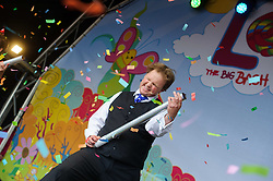 © Licensed to London News Pictures. 17/08/2013 London, UK. Justin Fletcher entertains the crowd at Lollibop Festival, Olympic Park, Stratford, London. The event billed as 'Glastonbury for Kids' will see over 45,000 visitors to watch TV favourites like Peppa Pig, Hello Kitty and JDick and Dom. Photo credit : Simon Jacobs/LNP