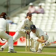 Hampshire's Nic Pothas sweeps the ball away from wicket keeper John Batty and Adam Hollioake