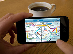 Looking at subway map of London on an Apple iphone 4G smart phone