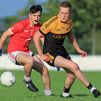 Coolmeen's Aidan Corry and Eire Og's Ben Quinn turn to take the ball