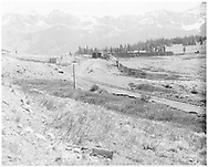 Distant view of Lizard Head showing south end of RGS snow sheds with track curving into them.  Section house also in view.<br /> RGS  Lizard Head, CO  ca. 1952