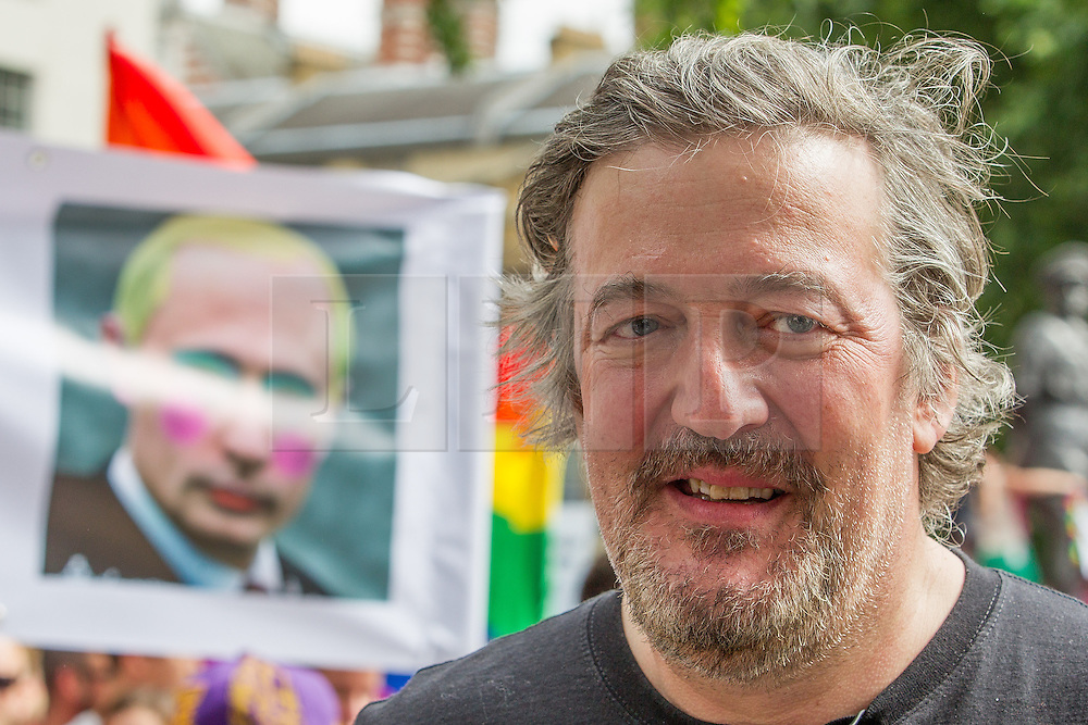 """© Licensed to London News Pictures . 10/08/2013 . London , UK . STEPHEN FRY at the demonstration . Protesters with placards . Demonstration against homophobic laws being enacted in Russia on Whitehall this afternoon (10th August 2013) . Legislation includes banning gay pride events for100 years , banning the distribution of """" propaganda of non-traditional sexual relations """" to minors , making it illegal for the adoption of Russian children by gay couples or any single person who comes from a country that recognises marriage equality and giving authorities the rights to arrest foreign nationals whom they suspect are LGBT or pro gay with the right to detain them for up to 14 days. Photo credit : Joel Goodman/LNP"""