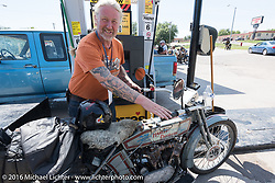 Thomas Trapp, owner of the Harley-Factory Frankfurt dealership in Germany fuels his 1916 Harley-Davidson during the Motorcycle Cannonball Race of the Century. Stage-8 from Wichita, KS to Dodge City, KS. USA. Saturday September 17, 2016. Photography ©2016 Michael Lichter.