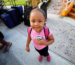 A young evacuee from Freeport, Bahamas, has her boarding tag ready before getting on Royal Caribbean's Mariner of the Seas cruise ship after it arrived in Freeport on Saturday, September 7, 2019. The ship delivered 10,000 relief meals and picked up refugees wanting to leave Freeport to go to Nassau after the island was devastated by Hurricane Dorian. Photo by Joe Burbank/Orlando Sentinel/TNS/ABACAPRESS.COM