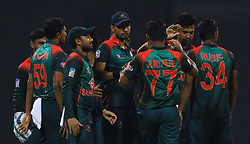 September 26, 2018 - Abu Dhabi, United Arab Emirates - Bangladesh cricket  captain Mashrafe Mortaza and team members celebrate after taking  a catch  during the Asia Cup 2018 cricket match  between Bangladesh and Pakistan at the Sheikh Zayed Stadium,Abu Dhabi, United Arab Emirates on September 26, 2018  (Credit Image: © Tharaka Basnayaka/NurPhoto/ZUMA Press)