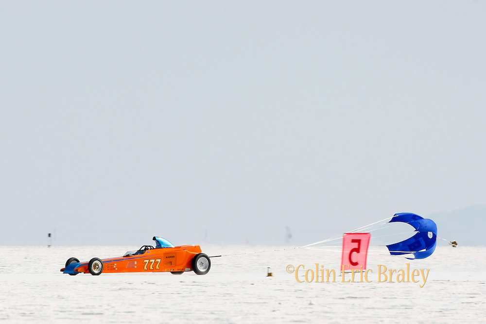Best-cars-people-atmosphere-photos of 2009 Bonneville Speed Week- Fjastad-Kinne Brothers-McNeil Racing's 1927 Ford Roadster, driven by Dennis McNeil and Pat Kinne of Santa Ana, CA. passes the five-mail marker during a run at the Bonneville Speed Way. August 9, 2009.  Photo by Colin E. Braley