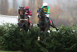 Josies Orders ridden by Mark Walsh (right) jumps the last with Fact of the Matter ridden by Gavin Sheehan (left) on their way to victory in the Glenfarclas Cross Country Handicap Chase during day one of the November Meeting at Cheltenham Racecourse.