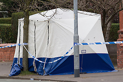 © Licensed to London News Pictures . 01/03/2013 . Manchester , UK . Forensic Scenes of Crime tent on Wilbraham Road , Chorlton , Manchester today (1st March 2013) . Police report they are investigating following the discovery of a body this morning (1st March) . Photo credit : Joel Goodman/LNP
