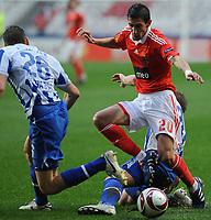 20100223: LISBON, PORTUGAL - SL Benfica vs Hertha Berlin: Europa League 2009/2010 - Round of 32 - 2nd leg. In picture: Angel Di Maria (Benfica) and Lukasz Piszczek (Hertha BSC Berlin). PHOTO: Alvaro Isidoro/CITYFILES