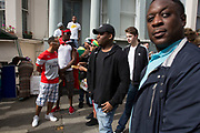 People gathering outside residences on Ladbroke Grove on Sunday 28th August 2016 at the 50th Notting Hill Carnival in West London. A celebration of West Indian / Caribbean culture and Europes largest street party, festival and parade. Revellers come in their hundreds of thousands to have fun, dance, drink and let go in the brilliant atmosphere. It is led by members of the West Indian / Caribbean community, particularly the Trinidadian and Tobagonian British population, many of whom have lived in the area since the 1950s. The carnival has attracted up to 2 million people in the past and centres around a parade of floats, dancers and sound systems.