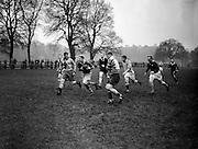 Irish Rugby Football Union, Ireland v Australia, Tour Match, Australian team and Irish team practice in College Park, Dublin, Ireland, Tuesday 14th January, 1958,.14.1.1958, 1.14.1958,..Irish Team, ..P J Berkery, Wearing number 15 Irish jersey, Full back, Landsdowne Rugby Football Club, Dublin, Ireland, and, London Irish Rugby Football Club, Surrey, England, ..A J F O'Reilly, Wearing number 14 Irish jersey, Right Wing, Old Belvedere Rugby Football Club, Dublin, Ireland, ..N J Henderson, Wearing number 13 Irish jersey, Captain of the Irish team, Right centre, N.I.F.C, Rugby Football Club, Belfast, Northern Ireland, ..D Hewitt, Wearing number 12 Irish jersey, Left centre, Queens University Rugby Football Club, Belfast, Northern Ireland,. .A C Pedlow, Wearing number 11 Irish jersey, Left wing, C I Y M S Rugby Football Club, Belfast, Northern Ireland, ..J W Kyle, Wearing number 10 Irish jersey, Stand Off, N.I.F.C, Rugby Football Club, Belfast, Northern Ireland, ..A A Mulligan, Wearing number 9 Irish jersey, Scrum Half, Cambridge University Rugby Football Club, Cambridge, England, and, London Irish Rugby Football Club, Surrey, England, ..B G M Wood, Wearing number 1 Irish jersey, Forward, Garryowen Rugby Football Club, Limerick, Ireland, ..R Dawson, Wearing number 2 Irish jersey, Forward, Wanderers Rugby Football Club, Dublin, Ireland, ..P J O'Donoghue, Wearing  Number 3 Irish jersey, Forward, Bective Rangers Rugby Football Club, Dublin, Ireland,  ..W A Mulcahy, Wearing number 4 Irish jersey, Forward, University College Dublin Rugby Football Club, Dublin, Ireland,..J B Stevenson, Wearing number 5 Irish jersey, Forward, Instonians Rugby Football Club, Belfast, Northern Ireland,..J A Donaldson, Wearing number 6 Irish jersey, Forward, Collegians Rugby Football Club, Belfast, Northern Ireland,..J R Kavanagh, Wearing number 7 Irish jersey, Forward, Wanderers Rugby Football Club, Dublin, Ireland, ..N Murphy, Wearing number 8 Irish jersey, Forward, Cork Constitution Rugby Footb