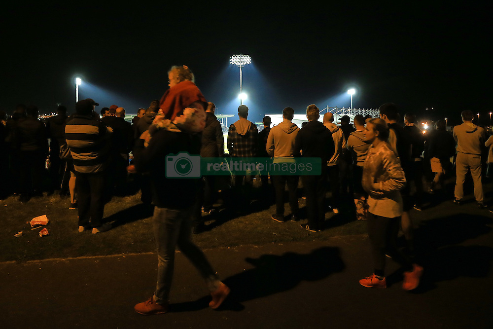 21 September 2016 - EFL Cup - 3rd Round - Northampton Town v Manchester United - Fans look on at the match at Sixfields Stadium from a nearby hilltop - Photo: Marc Atkins / Offside.