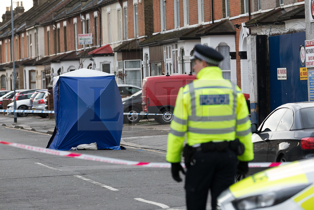 © Licensed to London News Pictures. 22/03/2017. LONDON, UK.  A police officer looks at a forensic tent in Bedford Road. A man has died after being shot in Ilford, east London. Police were called to reports of a shooting at the junction of Ilford Lane and Bedford Road in Ilford at 22:10 last night. Emergency services found the victim, a man unconscious with a gunshot wound and he died shortly after.  Photo credit: Vickie Flores/LNP
