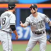 NEW YORK, NEW YORK - June 01:  Shortstop Tyler Saladino #18 of the Chicago White Sox and second baseman Brett Lawrie #15 of the Chicago White Sox congratulate each other on a double play during the Chicago White Sox  Vs New York Mets regular season MLB game at Citi Field on June 01, 2016 in New York City. (Photo by Tim Clayton/Corbis via Getty Images)