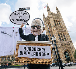© Licensed to London News Pictures. 12/09/2017. London, UK. Campaigners from Avaaz dressed as Rupert Murdoch  demonstrate outside Parliament against Rupert Murdoch's proposed takeover of Sky. Culture Secretary Karen Bradley has referred the £11.7bn deal to regulators over media plurality and broadcasting standards. Photo credit: Rob Pinney/LNP
