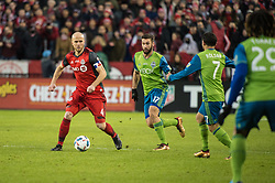 December 9, 2017 - Toronto, Ontario, Canada - Toronto FC midfielder MICHAEL BRADLEY (4) dribbles the ball defended against Seattle Sounders midfielder CRISTIAN ROLDAN (7) and Seattle Sounders defender WILL BRUIN (17) during the MLS Cup championship match at BMO Field in Toronto, Canada.  Toronto FC defeats Seattle Sounders 2 to 0. (Credit Image: © Mark Smith via ZUMA Wire)